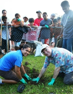 FSM Olympian Debra Daniel and USA Ambassador to the FSM, Peter A. Prahar, planting the first tree of the day.