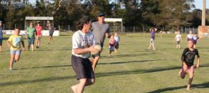 Kids v's Adults in a game of Touch Footy