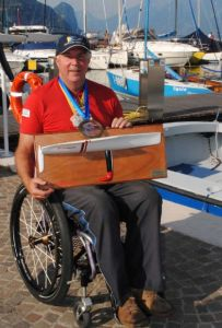 Russell Phillips with his bronze medal and travellers trophy from the 2011 Access Class European Championships