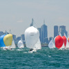 Large fleet of Etchells heads downwind with Melbourne's CBD behind them.