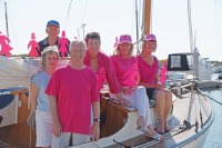 Gill Golland, pictured here with her team in preparation for QLYC's Pink Lady Regatta, presented at the Forum on her experienecs as Commodore and on being awarded the WGIS Local Hero Award
