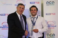 TRFM Gippsland League chair Greg Maidment with Trood Award and Rodda medallist Brad Scalzo of Warragul